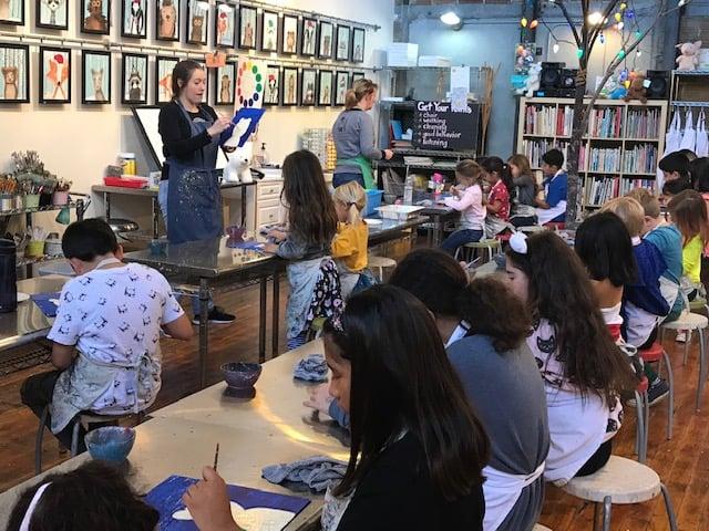 woman teaching at studio