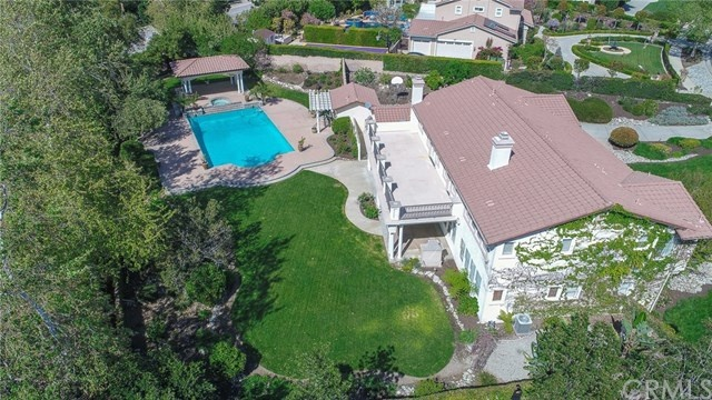 spacious backyard with pool and spa