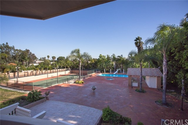 backyard patio with pool and tennis court