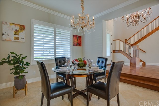 dining room with beautiful chandelier