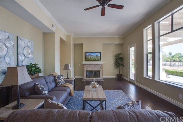 family room with big windows and a fireplace