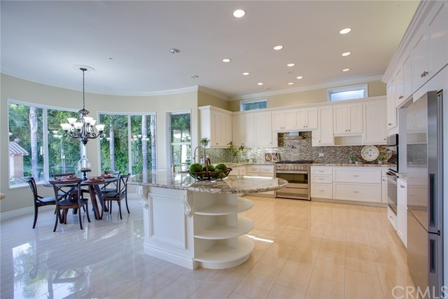 stunning gourmet kitchen and eat in nook