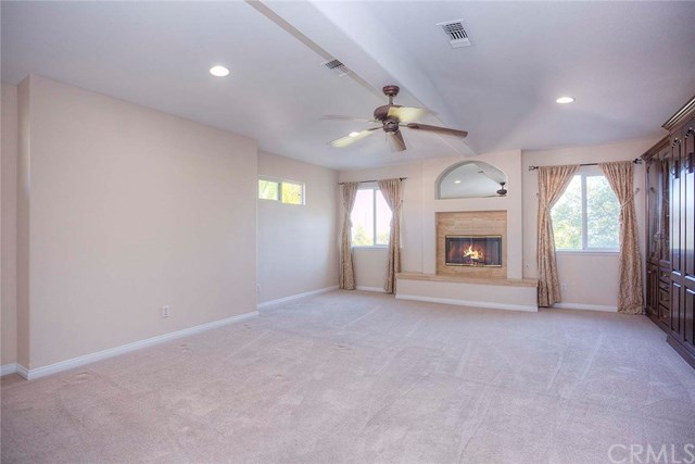 carpeted game room with fireplace